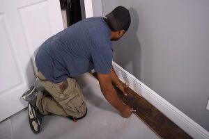 MC Brampton Flooring worker installing laminate flooring