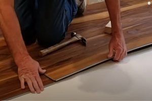Engineered wood flooring installation by Brampton Flooring worker.