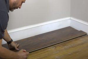 Vinyl floor installation by MC Brampton Flooring worker.